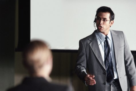 Businessman Giving a Presentation Using Petrana